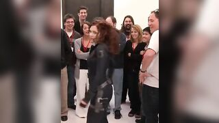 Would've loved it if all those men and women swarmed on Scarlett Johansson when she turned around, and ripped that suit off of her tight body. - Celebs